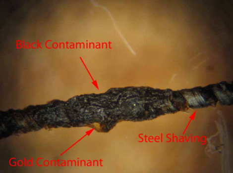 black and gold contaminant